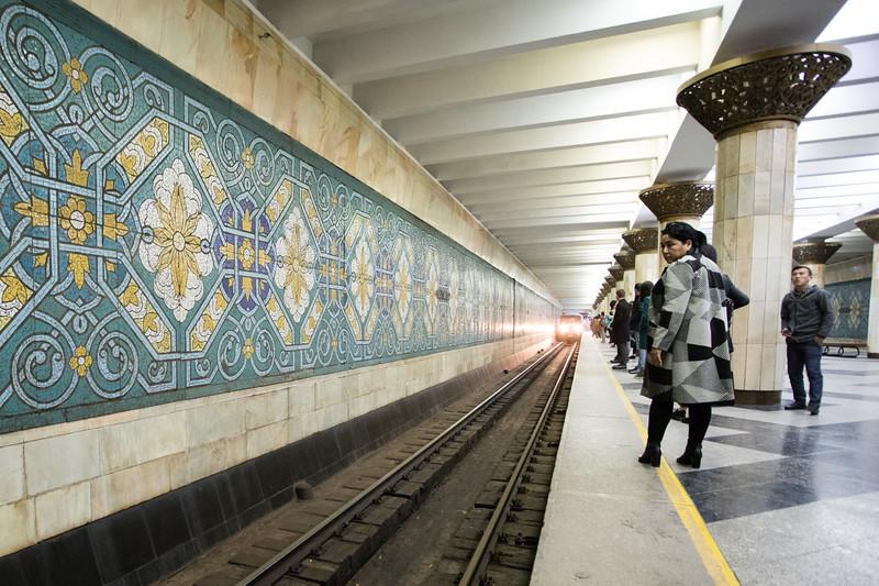 Passengers wait for a train in the Pakhtakor station in the Soviet-era metro system of Tashkent, Uzbekistan.