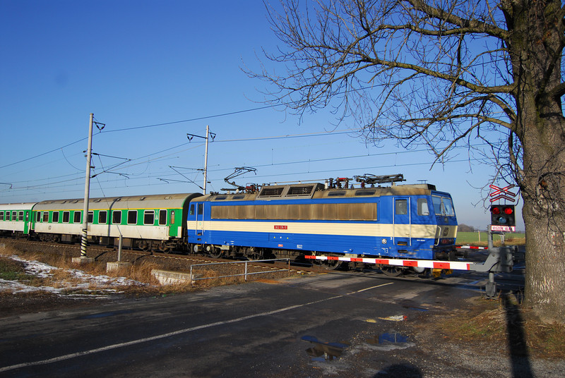 A CD Class 362 Express Loco hits the level crossing at Tatce, Czech Republic.