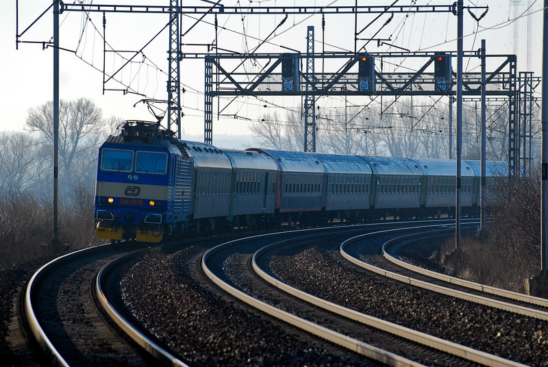 An express train from Prague on the Triple Track at Klučov‎.
