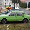 A green Skoda in front of the Hotel in Prague.