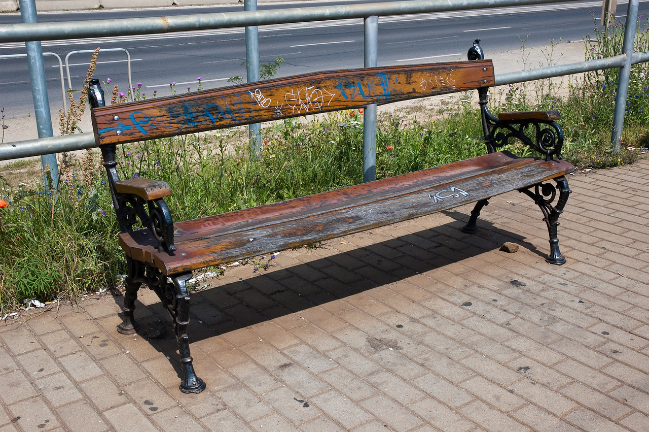 This bench at the train station outside the airport has seen better days, but I like this classic look...
