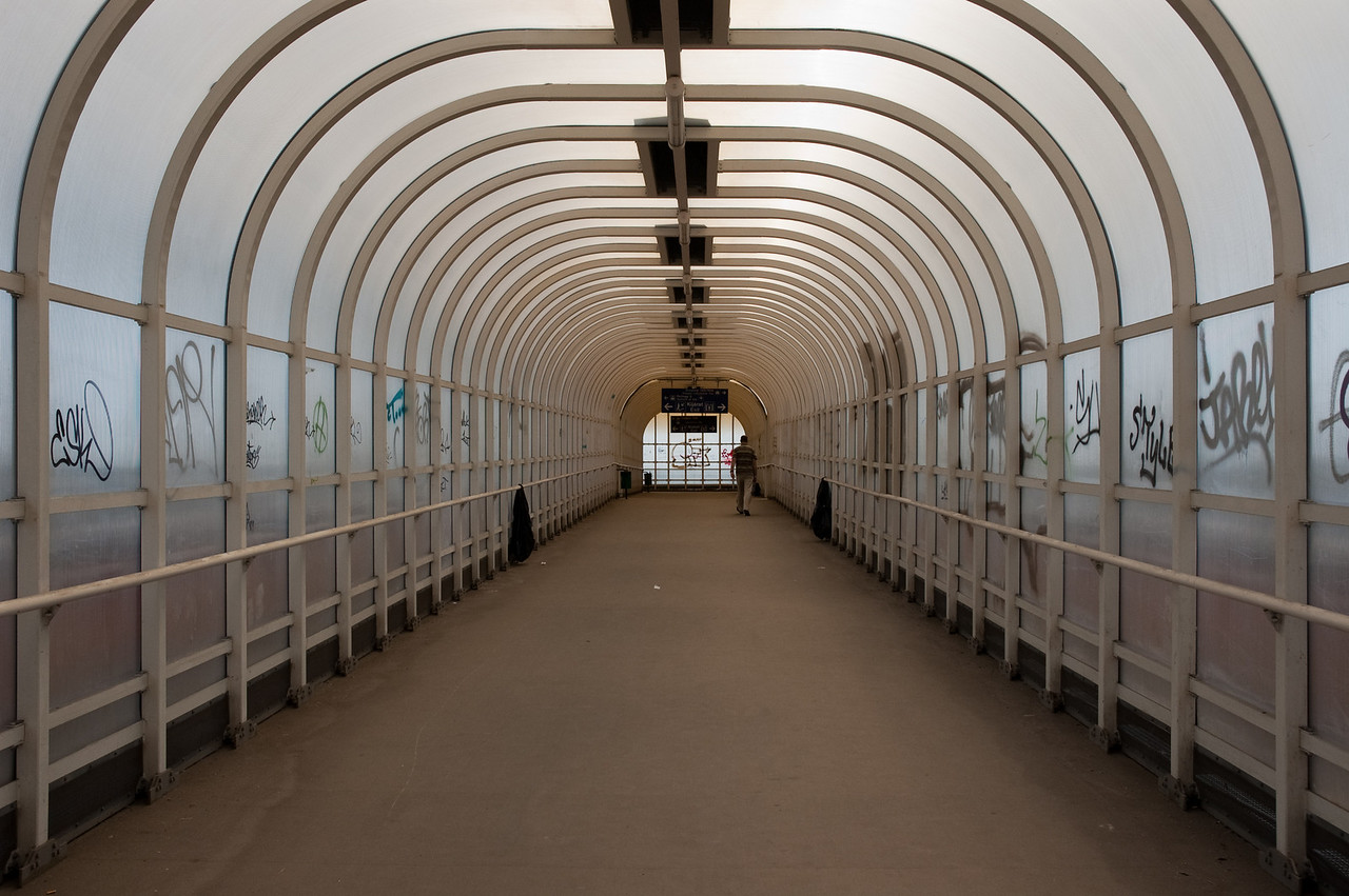 The overhead passageway that connects the airport and trainstation on the other side of the road.