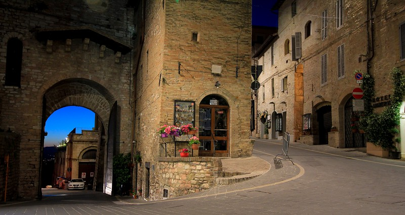Entrance to medieval Assisi, Italy. You have to walk into the city through these big doors from a dropoff area quite a few yards below. Very limited parking.