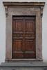A wooden side door in Lucca.