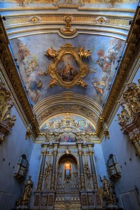 A small church in Assisi had a stark facade with weathered Roman columns which gave no clue as to the fancy Baroque interior.