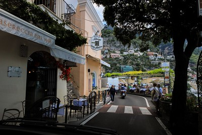 """One of those """"are you kidding?"""" moments. Traffic entering Positano's shopping district zooms through blind turns within inches of pedestrians (and packed dining tables). It ends well because Italians know how to drive."""