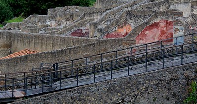 Portions of colorful wall treatments, frescoes and tiles survived the volcano and the crushing weight of debris.