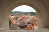 View of Cesky Krumlov through a castle wall window.