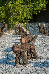 Various animal sculptures at the Rock Garden. The Rock Garden of Chandigarh (also known as Nek Chand's Rock Garden after its founder) is a sculpture garden in Chandigarh, India. Nek Chand was a government official who started the garden secretly in his spare time in 1957. Today it is spread over an area of 40 acres and is completely built of industrial and home waste and thrown-away items. The Rock Garden, is one of the most famous sites in India. Nek Chand, the creator of this place, died in 2015 but his site is visited by millions of people every year.