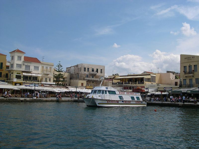 Chania harbor with tour boat.