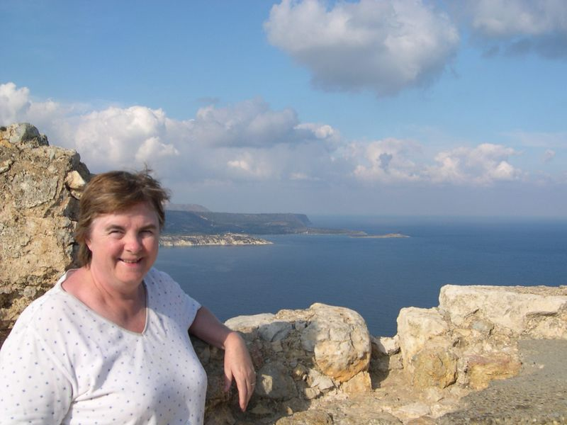 Susan looking over Souda Bay from the old Turkish fort at Aptera.