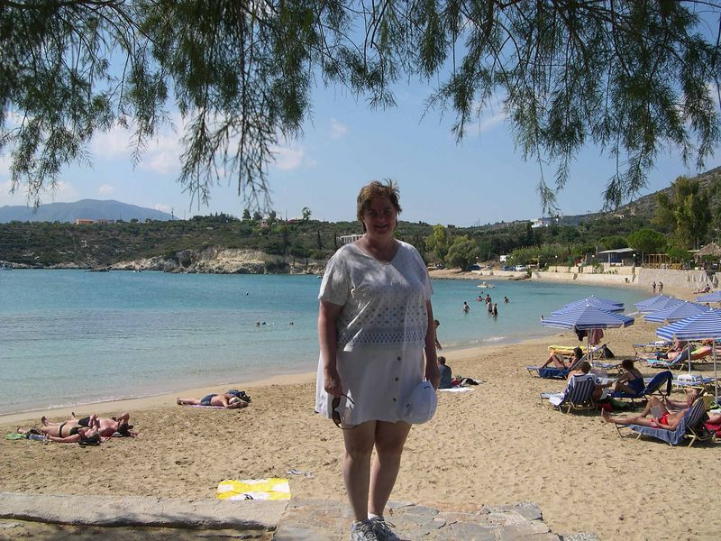 Susan getting ready to go swimming at Maleme.