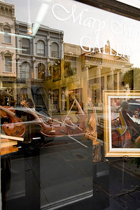 Reflection of South Carolina Bank and Trust in the window of the Mary Martin Gallery...Broad Street...spectacular gallery!