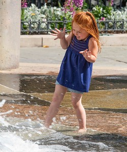 Cooling off on a hot day in Waterfront Park fountain
