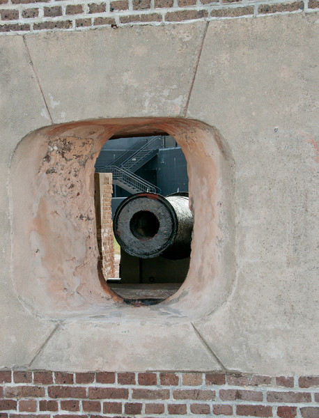 View of a cannon looking into Fort Sumter