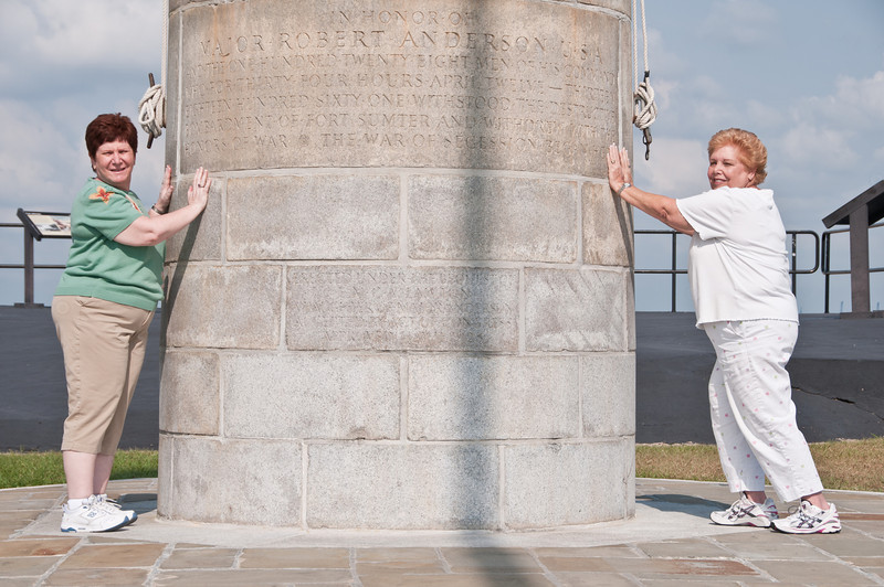 Barbara and Sandy holding the flagpole monument upright at For Sumter