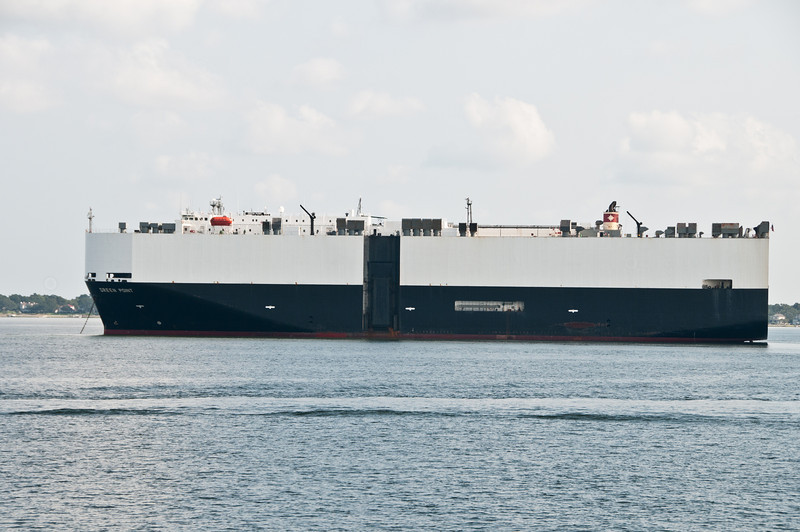 A car cargo ship waiting on the Cooper River to enter the port to unload its cargo.