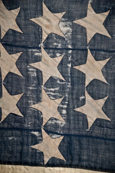 Fort Sumter - The 33-star United States Flag.  Look closely and you will see a face with a union hat on this flag by the stars.