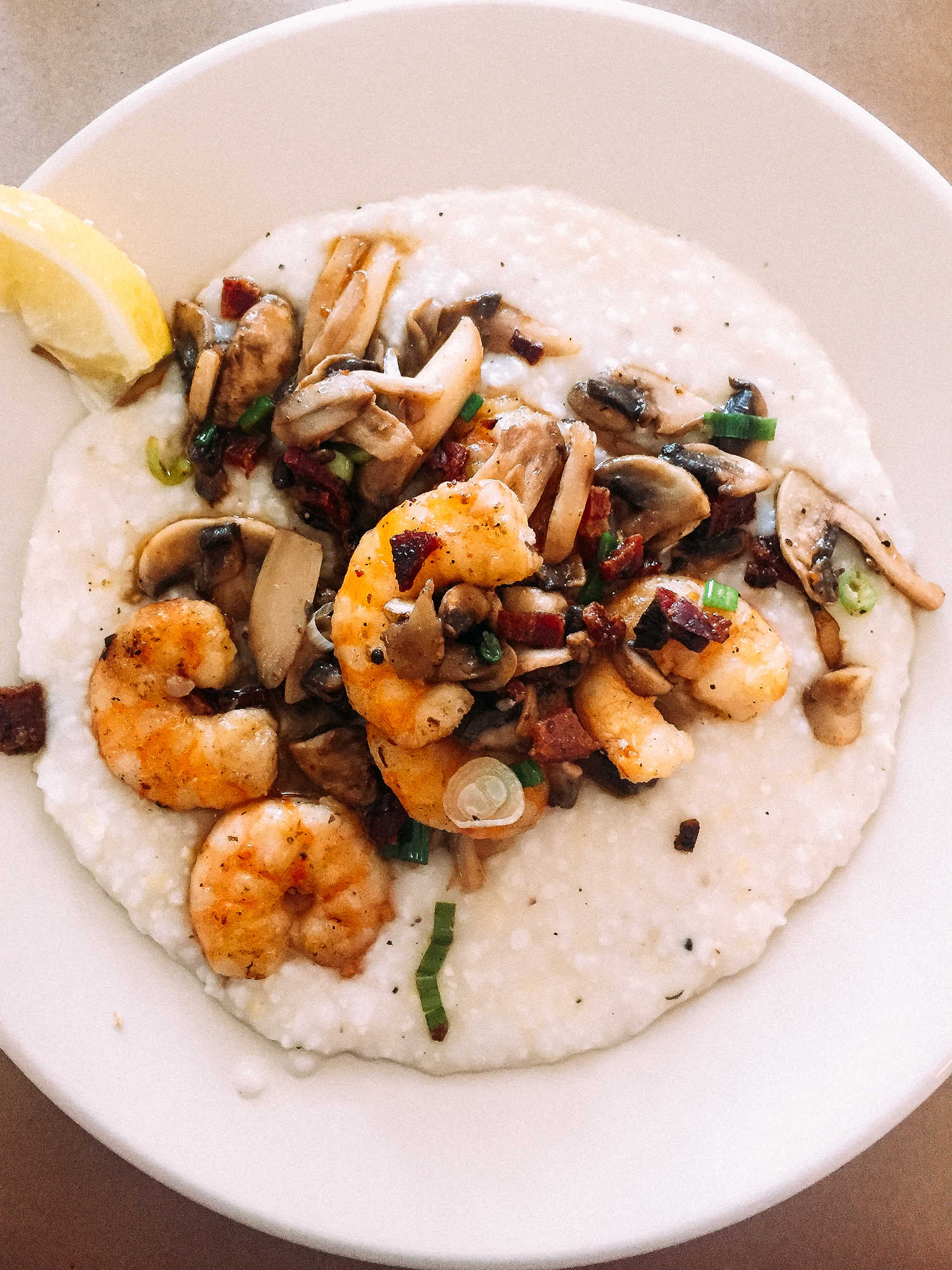 Shrimp and grits in Charleston, one of the cities to make our list of where to eat in 2016.