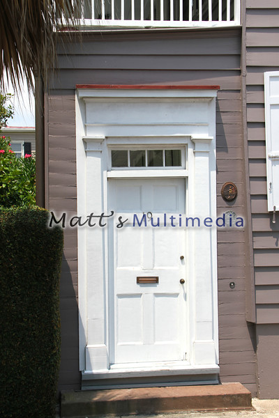 The emblem next to the door is a colonial fire insurance sign. Back them you had to pay a private company to put out fires if you ever had one!