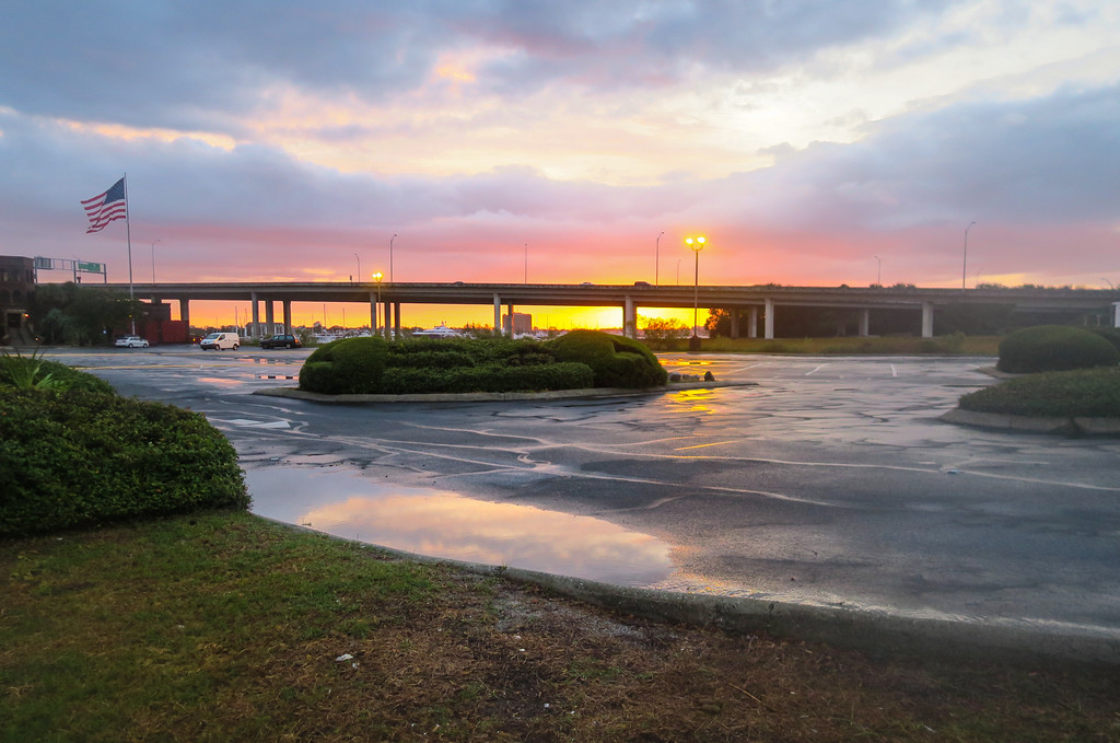 I was hoping for sunrise over the water, but I got it coming up behind a freeway bridge and parking lot. Still like the colors.