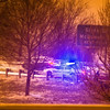 police helping injured driver after a crash during winter snowstrom in the south