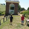 Boys wandering around Jefferson's garden.