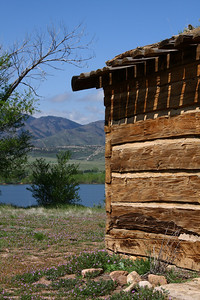 Slocum Cabin with Chatfield Reaervoir in the background.