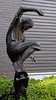 Bronze Sculpture of a Boy on a Skate Board