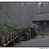 Mingus Mill, Great Smoky Mountains National Park--North Carolina<br /> <br /> The current mill built in 1886 by Sion Early, a millwright from VA, for six hundred dollars,  actually replaced a worn out mill powered by a waterwheel, built n the 1790's by the Mingus family, who owned it until in the 1930's when the National Park acquired it.  It was a 'custom mill' catering to each customers personal preference.  Parts of this mill were replaced in 1937, again in1968, as parts that get wet then dry then wet again are subject to rot.  Notice it  has already been running beyond the 31 year span that required replacing rotted parts, possibly due to more modern pressure treated or better known as of preserving wood. The mill operates during the summer as a historical exhibit.  What you WONT see is a traditional water wheel!  This mill is powered by a turbine manufactured by the James Leffel and company which builds turbines from home size to huge hydroelectric plant sizes.  This turbine operates by water moving through its vanes, developing eleven horsepower at 400 RPM, rotating a vertical shaft that powers all the machinery in the mill, along with taking less space than a water wheel with lower maintenance and less expense.