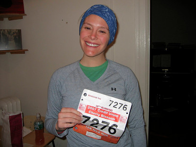 Me + running bib @ 6:30am...notice the piano in the background....clearly NOT my apartment!