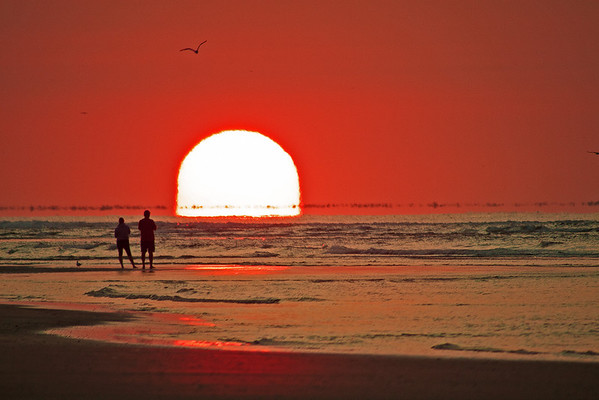 This shot of the sunrise at Cherry Grove beach was taken with a Canon 50D and a Vivitar 100-500mm manual telephoto lens.