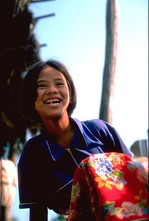 Local hill tribe girl laughing in Chiang Dao Thailand