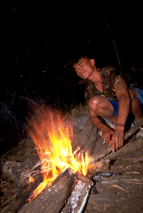 Nop making a fire for us in Chiang Dao Thailand