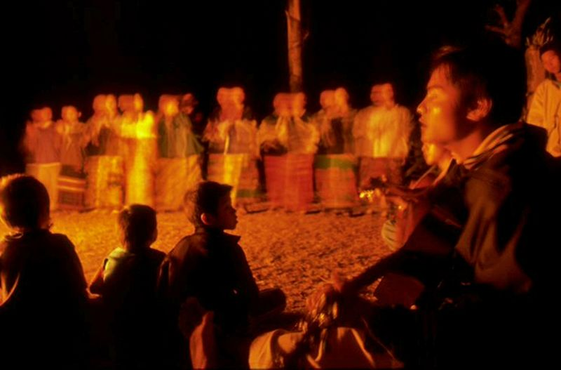 Hill tribe boy plays guitar for dance in Chiang Dao Thailand