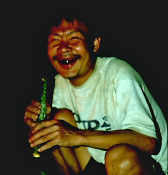 Local hill tribe man laughing with black teeth in Chiang Dao Thailand