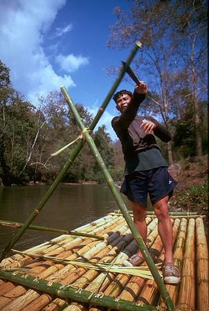 Daeng cutting our bamboo raft in Chiang Dao Thailand