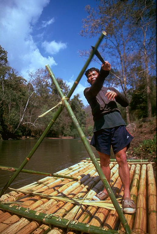 Daeng cutting our bamboo raft in Chiang Dao Thailand