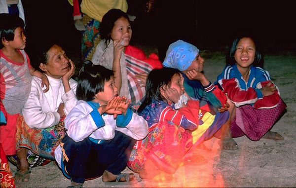 Hill tribe kids and elders around fire in Chiang Dao Thailand