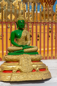 "Buddha statues Wat Phrathat Doi Suthep (วัดพระธาตุดอยสุเทพ), Chiang Mai Province, Thailand. The temple is often referred to as ""Doi Suthep"" although that is the name of the mountain where it's located. This is a sacred site to many Thai people and is also referred as the ornate temple complex. The complex features a golden stupa, statues & a legendary white elephant shrine."