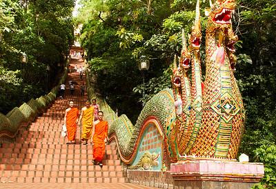 Wat Phrathad Doi Suthep stairs with novice Monks