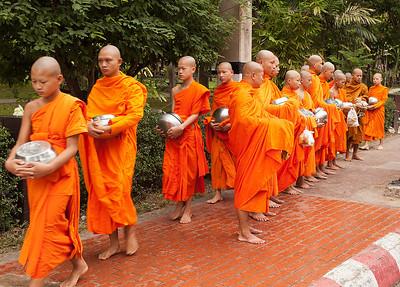 monks preparing to receive food