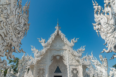 Wat Rong Khun White Temple (วัดร่องขุ่น)  Contemporary Buddhist temple drawing massive crowds with its unique, intricate white exterior. Wat Rong Khun, also known as the White Temple, is a contemporary, unconventional, privately-owned art exhibit in the style of a Buddhist temple in Chiang Rai Province, Thailand.