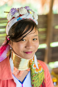 Long Neck Karen in Chiang Rai, Chang Wat Chiang Rai, Thailand The Karen are a tribal group who have historically lived in the hills on the Myanmar (formerly Burma) side of the Thai border. Best recognized for their elongated necks, the Karen women wear heavy brass rings around their necks, forearms, and shins. There is a lot of criticism surrounding this. From human-zoo to women earning a honest living and not being prosecuted. Depending on which side of the argument you are. When we first arrived each woman was stationed by her own hut busy working on the knitting looms and it initially felt a little bit like a staged atmosphere but talk and spend time and it feels not very different than other villages. Controversy or not, had mixed feelings on this.