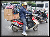 Load on a motor scooter.