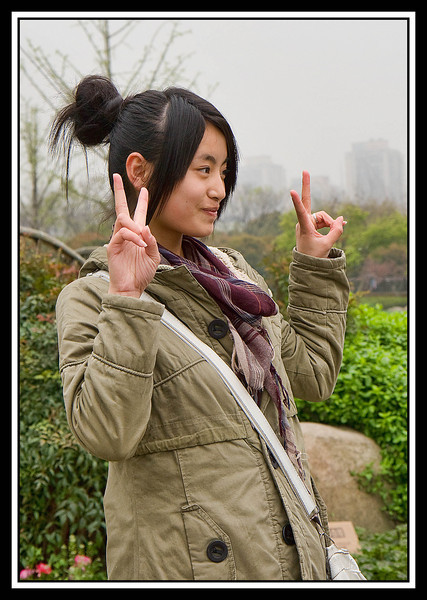 "The ""V"" gesture is common when Chinese are being photographed..."