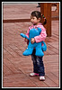 "Little girl with her ""Hai Bao"" Expo Mascot doll..."