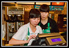 Clerks working on cash register.