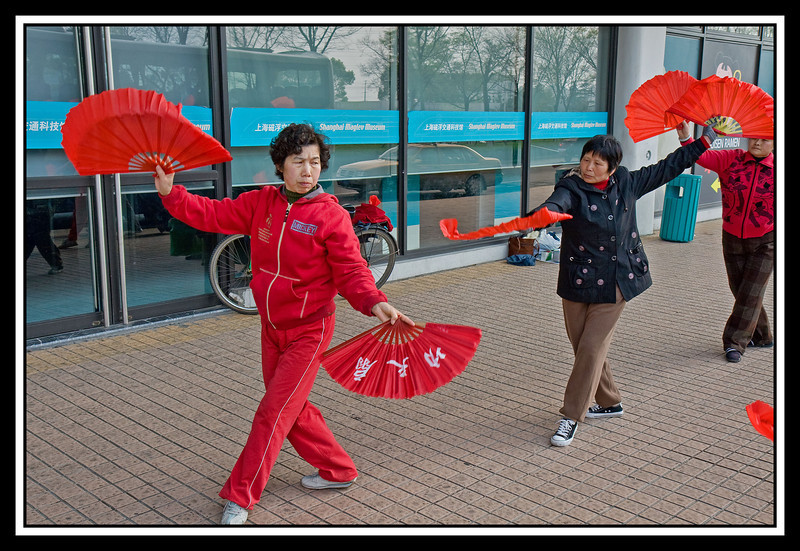 Fan dancers exercising in front of Maglev Station...