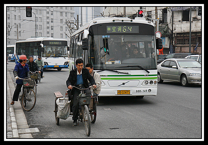 Bikes share street with buses and cars...